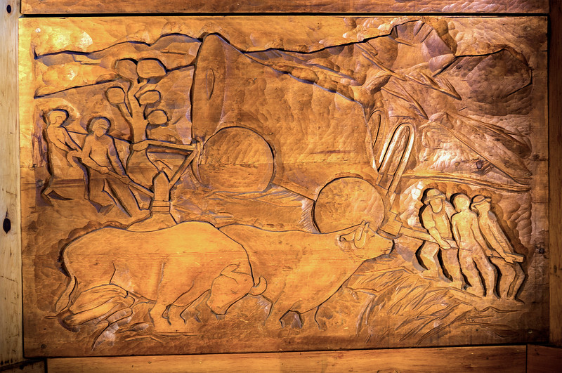 Primitive historical wood carving in the entryway