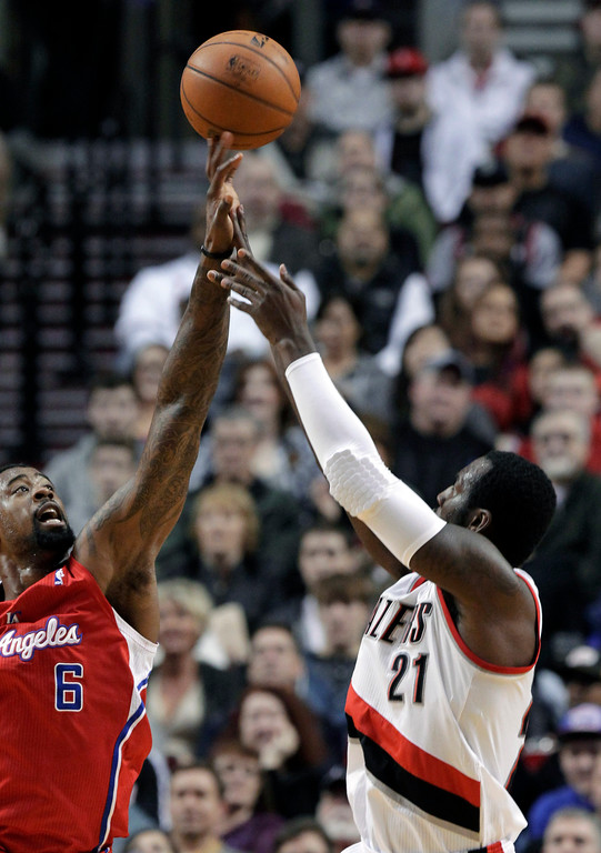 . Los Angeles Clippers center DeAndre Jordan, left, blocks a shot by Portland Trail Blazers center J.J. Hickson during the first quarter of an NBA basketball game in Portland, Ore., Saturday, Jan. 26, 2013. (AP Photo/Don Ryan)