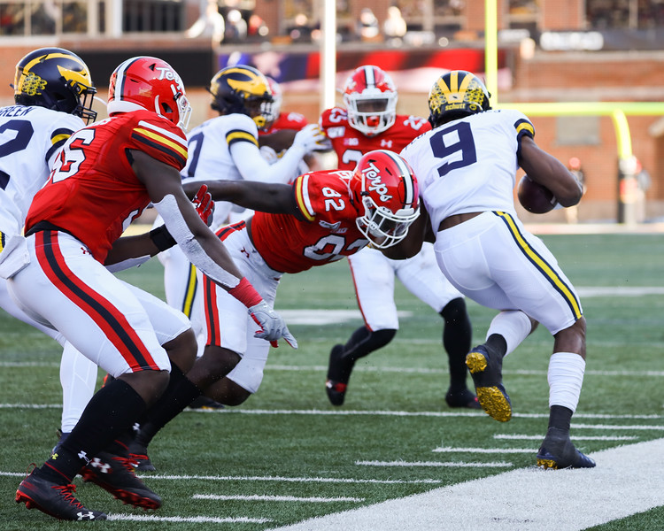 Maryland WR Isaiah Hazel pushes Michigan PR Donovan Peoples-Jones out of bounds.