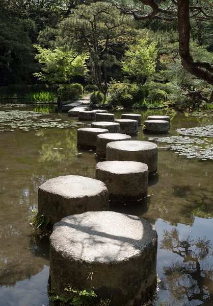 Stepping stones in pond at Gardens of Heian Jingu Shrine, Kyoto, Japan