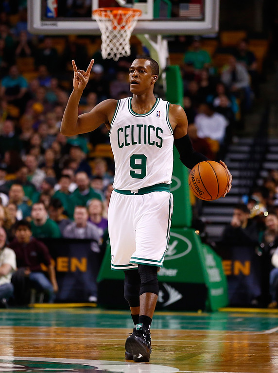 . BOSTON, MA - JANUARY 17:  Rajon Rondo #9 of the Boston Celtics carries the ball down the court against the Los Angeles Lakers in the first quarter during the game at TD Garden on January 17, 2014 in Boston, Massachusetts.   (Photo by Jared Wickerham/Getty Images)