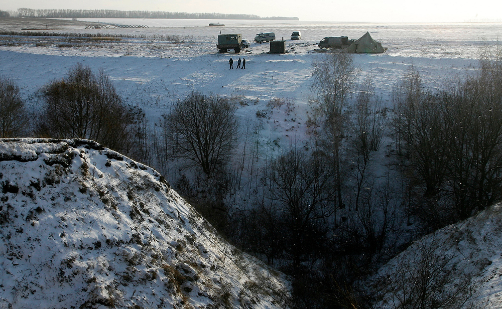 . A police encampment stands above the underground hideout where more than two dozen members of a doomsday cult are holed up, as they wait for what they say is going to be the end of the world, near the village of Nikolskoye, in Penza region about 400 milessoutheast of Moscow on Sunday Nov. 18, 2007.  Twenty-nine people, including four children, the youngest 18 months, retreated to the bunker near the village of Nikolskoye earlier this month and have threatened to blow themselves up if forced to leave. Priests tried unsuccessfully to coax members of a doomsday cult from the underground hideout where they remained barricaded Sunday. (AP Photo/Mikhail Metzel)