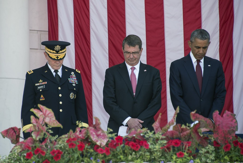 . US President Barack Obama (R), Defense Secretary Ashton Carter (C) and chairman of the Joint Chiefs of Staff Gen. Martin Dempsey (L) attend Memorial Day ceremonies on May 25, 2015 at Arlington National Cemetery in Arlington, Virginia. Memorial Day, originally called Decoration Day, is a day of remembrance for those who have died in service of the United States of America.   AFP PHOTO/NICHOLAS KAMMNICHOLAS KAMM/AFP/Getty Images