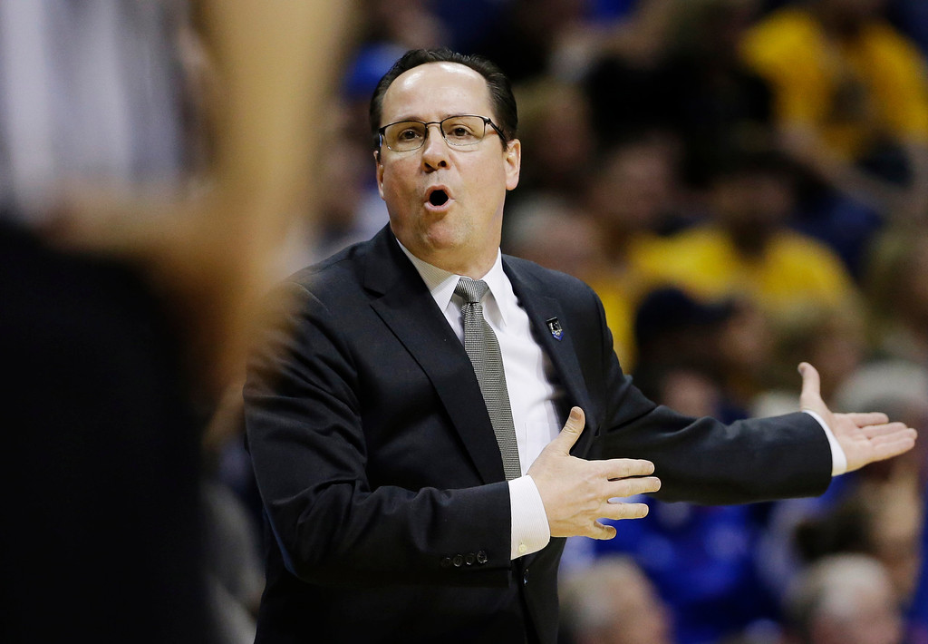 . Wichita State head coach Gregg Marshall appeals to an official against Kentucky  during the second half of a third-round game of the NCAA college basketball tournament Sunday, March 23, 2014, in St. Louis. (AP Photo/Jeff Roberson)