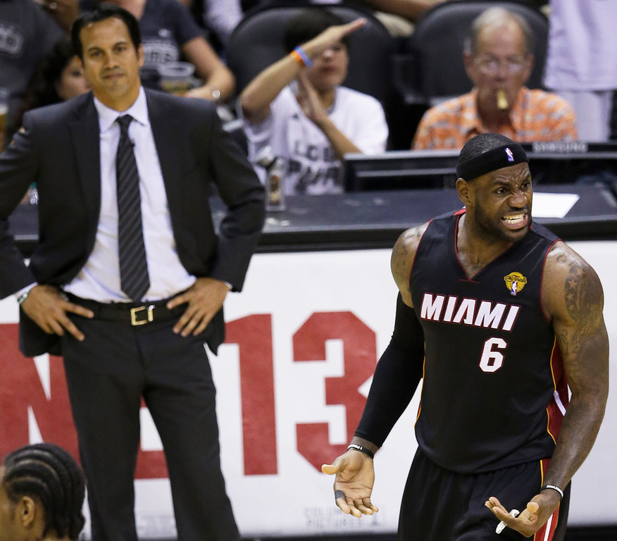 . As Miami Heat head coach Erik Spoelstra looks on, forward LeBron James (6) reacts against the San Antonio Spurs during the second half in Game 2 of the NBA basketball finals on Sunday, June 8, 2014, in San Antonio. (AP Photo/Tony Gutierrez)