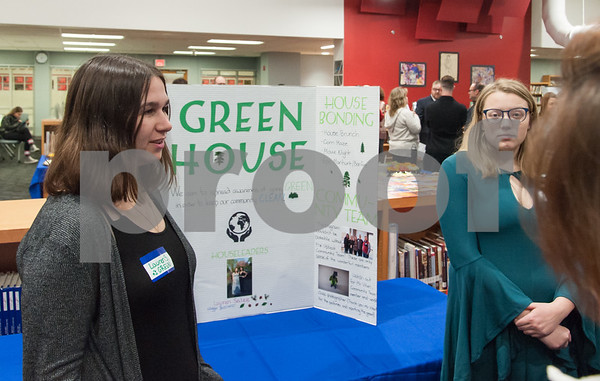 12/12/17 Wesley Bunnell | Staff The Berlin Upbeat Club held their 2017-18 Senior Expo on Tuesday evening at the high school. The expo featured Upbeat House Leaders discussing the focus of each house's activities. Lauren Salee, L, and Maggie Yaccovino from Green House speaking with a visitor.