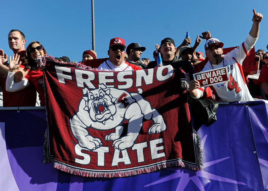 . LAS VEGAS, NV - DECEMBER 21:  Fans of the Fresno State Bulldogs cheer during the team\'s game against the USC Trojans in the Royal Purple Las Vegas Bowl at Sam Boyd Stadium on December 21, 2013 in Las Vegas, Nevada. USC won 45-20.  (Photo by Ethan Miller/Getty Images)