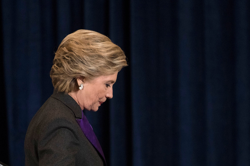 . Democratic presidential candidate Hillary Clinton walks off the stage after speaking in New York, Wednesday, Nov. 9, 2016. Clinton conceded the presidency to Donald Trump in a phone call early Wednesday morning, a stunning end to a campaign that appeared poised right up until election day to make her the first woman elected U.S. president.(AP Photo/Matt Rourke)