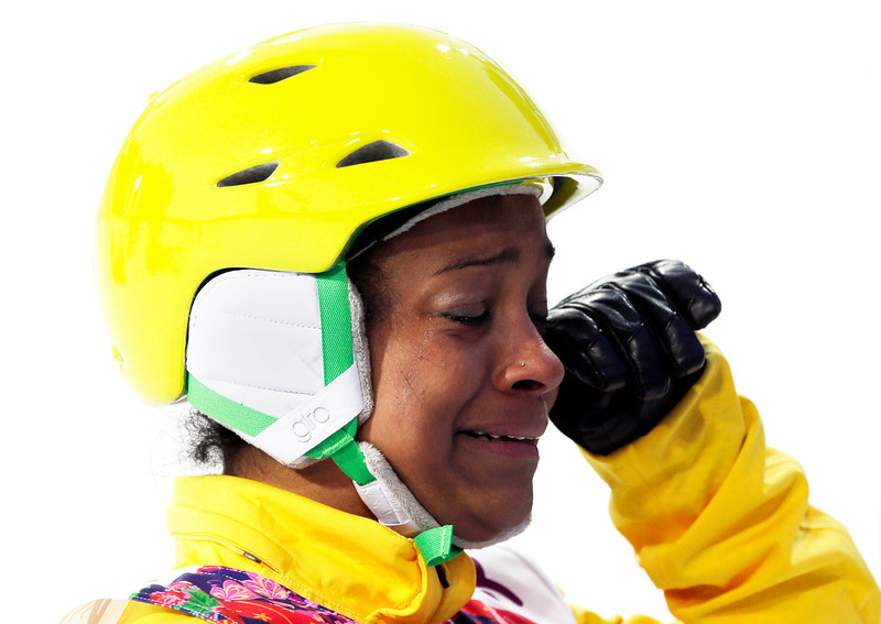 . Brazil\'s Joselane Santos cries after her jump during the women\'s freestyle skiing aerials qualifying at the Rosa Khutor Extreme Park, at the 2014 Winter Olympics, Friday, Feb. 14, 2014, in Krasnaya Polyana, Russia. (AP Photo/Andy Wong)