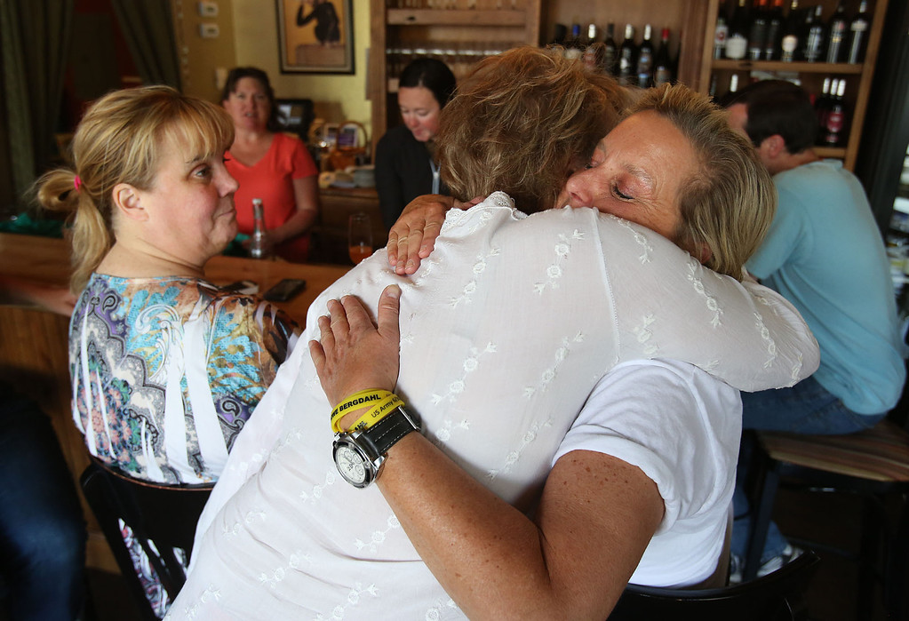 . Lee McCune, right, hugs Freda Avery to celebrate the news of U.S. Army Sgt. Bowe Bergdahl\'s release on Saturday, May 31, 2014 in Hailey, Idaho, his hometown. Bergdahl, 28, had been held prisoner by the Taliban since June 30, 2009. He was handed over to U.S. special forces by the Taliban in exchange for the release of five Afghan detainees held by the United States. McCune, who knows Bergdahl, has worn yellow bracelets to show support during his captivity. (AP Photo/The Times-News, Ashley Smith)