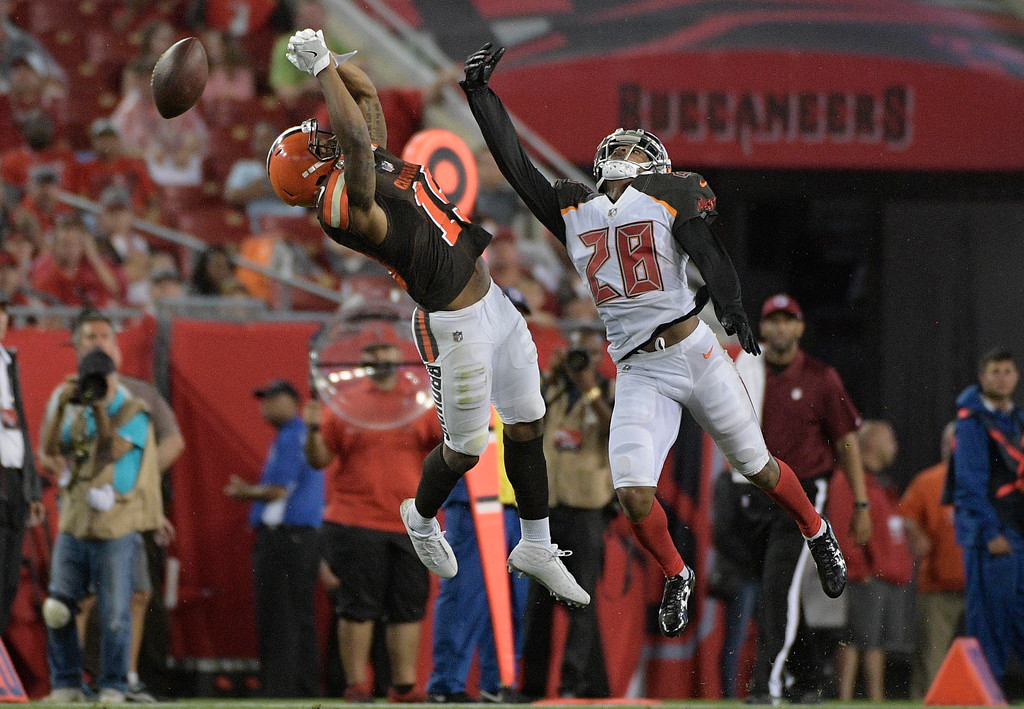 . Tampa Bay Buccaneers cornerback Vernon Hargreaves (28) tips the pass away from Cleveland Browns wide receiver Corey Coleman during the third quarter of an NFL preseason football game Saturday, Aug. 26, 2017, in Tampa, Fla. (AP Photo/Phelan Ebenhack)