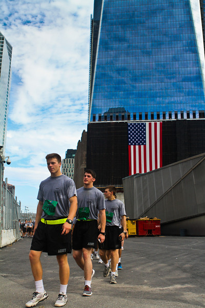 Cadets at Ground Zero who have just finished  running the Tunnels to Tower 5k, assemble into a file to get a tour of the recently opened 9/11 memorial on September 25, 2011.