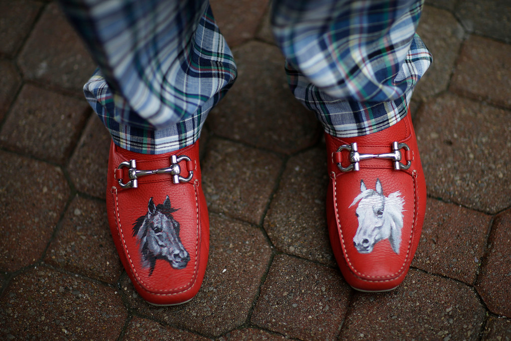 . James Cowheard, from Las Vegas, Nev., shows off his fancy shoes before the running of the 139th Kentucky Derby at Churchill Downs Saturday, May 4, 2013, in Louisville, Ky. (AP Photo/David Goldman)
