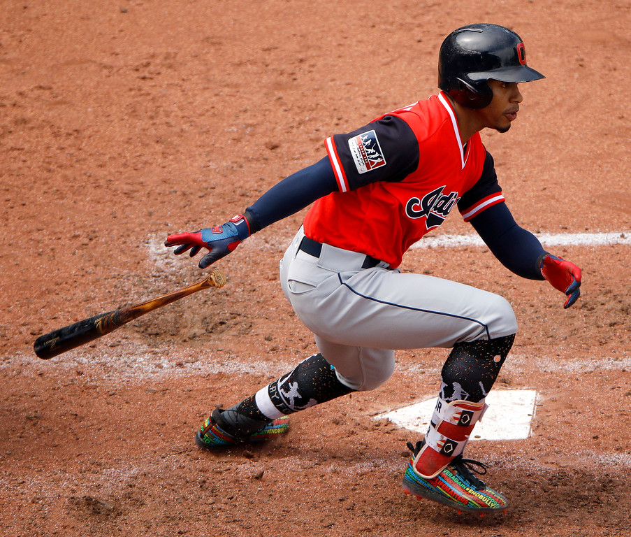 . Cleveland Indians\' Francisco Lindor runs to first after hitting a two-run single during the sixth inning of a baseball game against the Kansas City Royals Sunday, Aug. 26, 2018, in Kansas City, Mo. (AP Photo/Charlie Riedel)