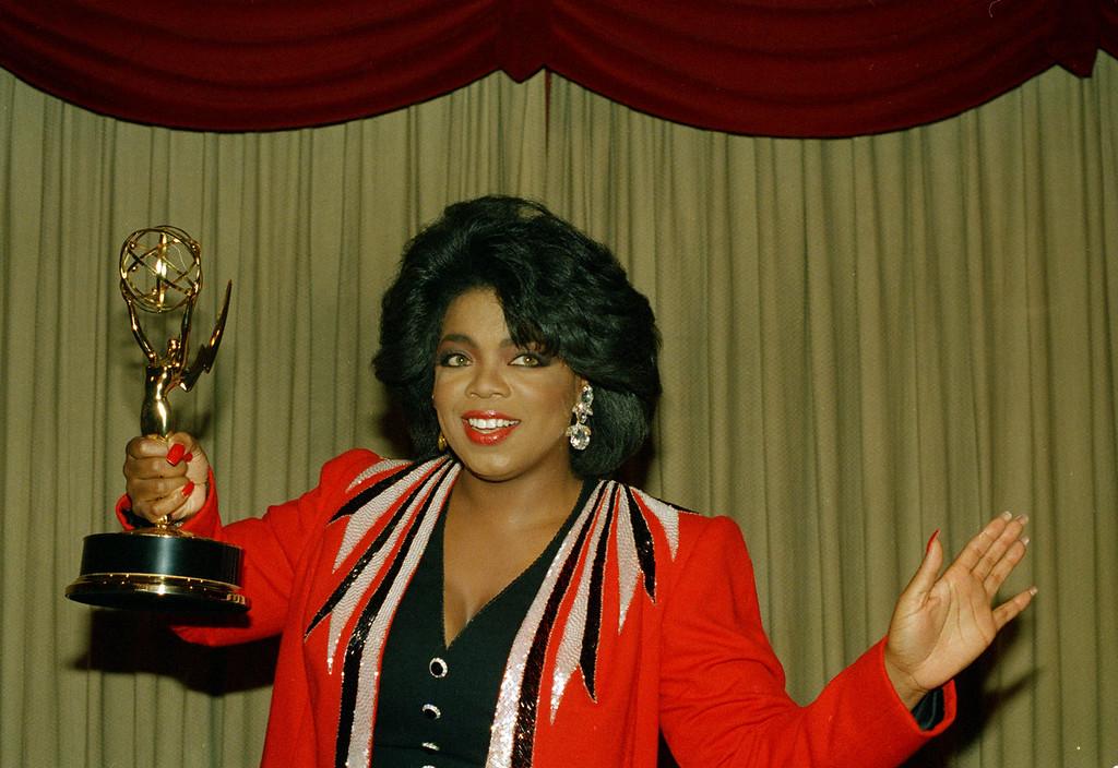 . Television talk show host Oprah Winfrey shows off her Daytime Emmy award, 1987.  (AP Photo)