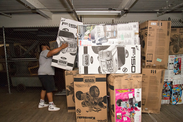 07/11/19 Wesley Bunnell | Staff Ronnie Palma, a NB Parks and Rec employee, stacks a toy car inside of a warehouse at 1 Hartford Square on Thursday morning. Approximately 300 toy cars were donated and delivered by Fisher-Price on to expand the Go Baby Go! program which is a learning project between New Britain High School and CCSU students in the technology fields. The program helps children with limited mobility by modifying toy cars for the exact needs of each child.