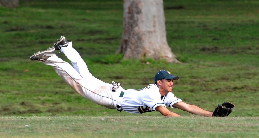 . Schurr center fielder Armando Rodriguez (#27) lays out for a fly ball to end the inning as they play San Gabriel in their Almont League game at Whittier Narrows Recreation Area in South El Monte on Friday April 5, 2013. San Gabriel beat Schurr 8-5. (SGVN/Staff Photo by Keith Durflinger)