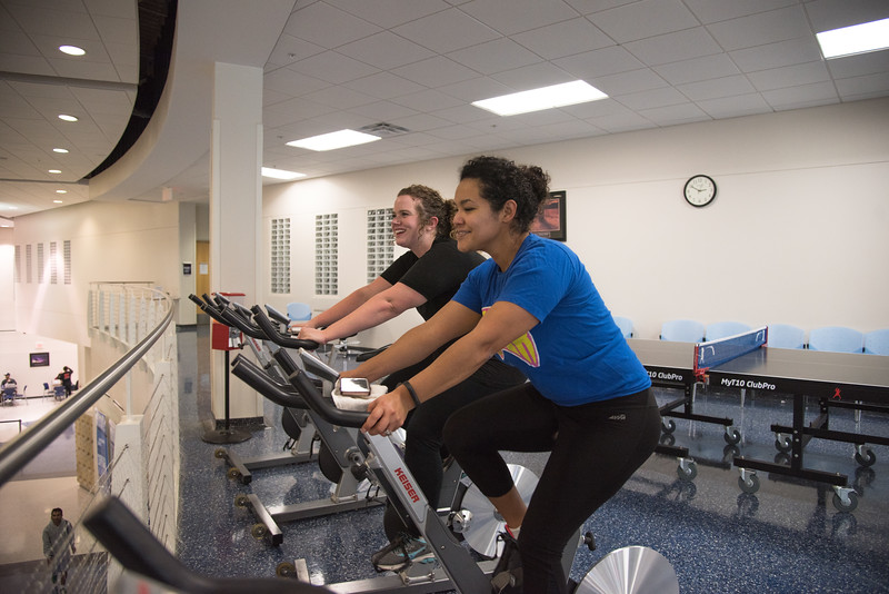 Michelle Culver (left) and Diana Del Angel utilize the gym located in the Dugan Wellness Center.