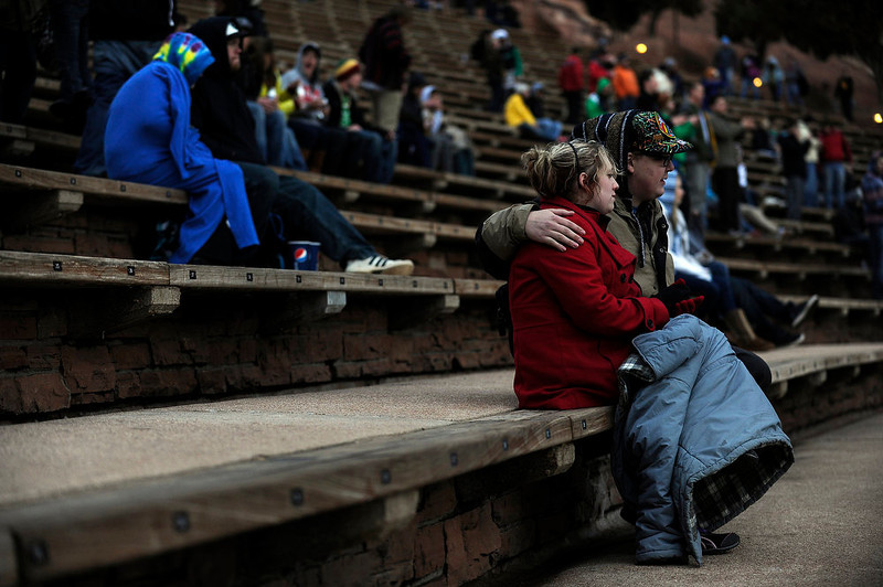 . A couple huddles against the cold as they listen to Tribal Seeds play  at Red Rocks on Saturday, April 20, 2013 during Slightly Stupid\'s 420 Hot Box as a part of the High Times US Cannabis Cup. Seth A. McConnell, The Denver Post