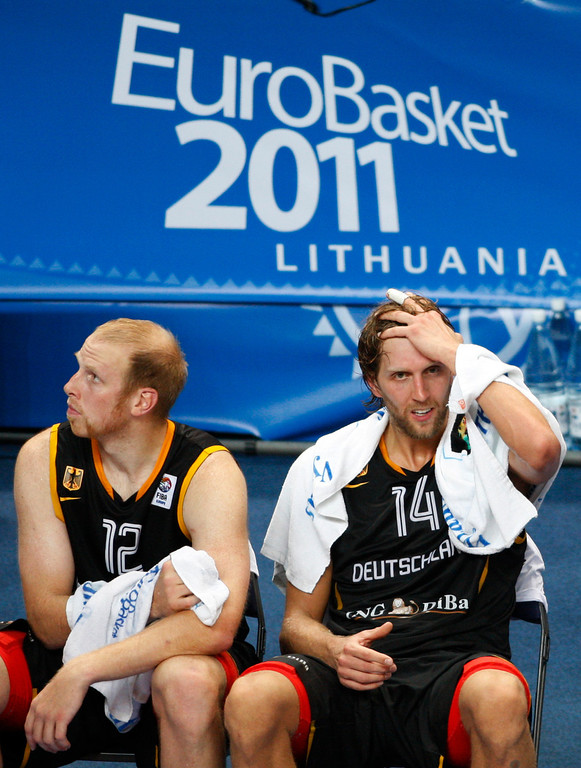 . Dirk Nowitzki, right, and Chris Kaman, left, both from Germany during the EuroBasket European Basketball Championship Group E match against Lithuania in Vilnius, Lithuania, Sunday, Sept. 11, 2011. Lithuania won the match 84-75. (AP Photo/Petr David Josek)