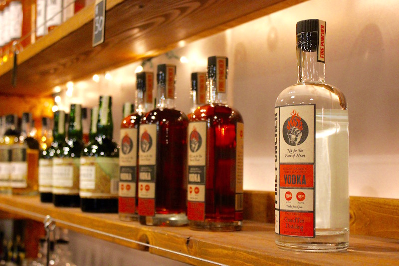 bottles on a shelf at GrandTen Distilling, a small batch distillery in Boston, Massachusetts