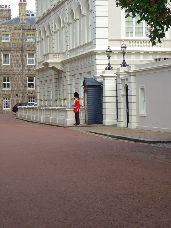 A lone guard at one of the buildings on the main street leading to the Palace. That was as close as I could get due to safety barricades.