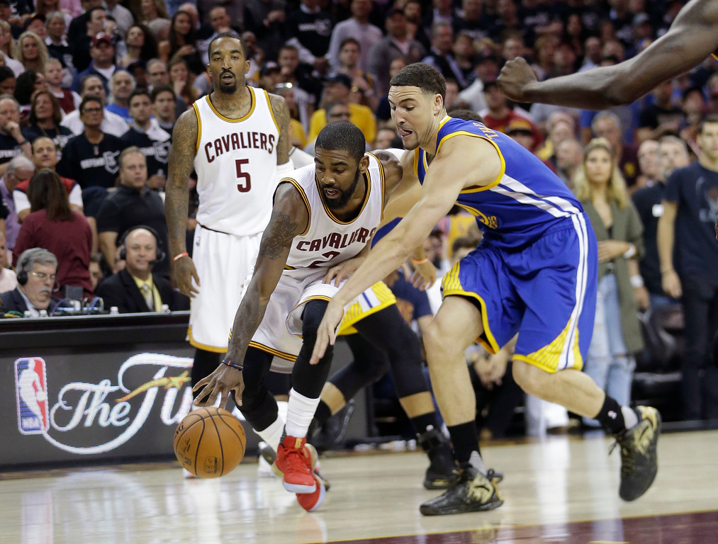 . Cleveland Cavaliers guard Kyrie Irving (2) drives on Golden State Warriors guard Klay Thompson (11) during the first half of Game 4 of basketball\'s NBA Finals in Cleveland, Friday, June 9, 2017. (AP Photo/Tony Dejak)