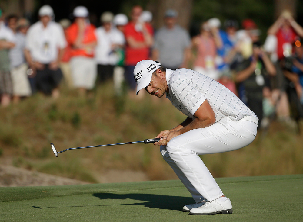 . Henrik Stenson, of Sweden, reacts after missing a putt on the 16th hole during the third round of the U.S. Open golf tournament in Pinehurst, N.C., Saturday, June 14, 2014. (AP Photo/David Goldman)