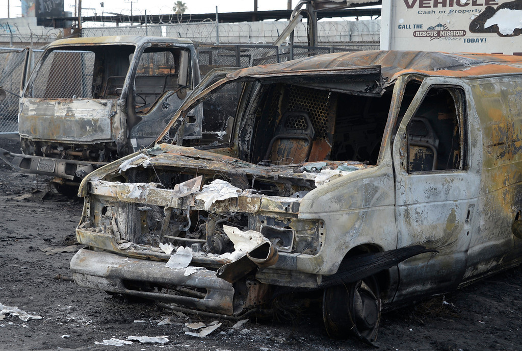 . The charred remains of the San Fernando Valley Rescue Mission\'s vehicle fleet on May 8, 2014 after a fire destroyed the mission\'s North Hollywood emergency shelter, clothing warehouse and food pantry. (Photo by Gene Blevins/Los Angeles Daily News)