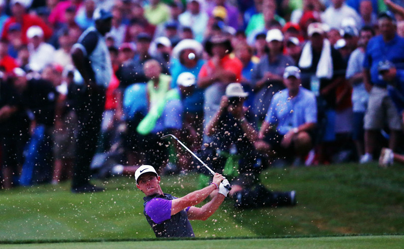 . Rory McIlroy of Northern Ireland hits a shot from a greenside bunker on the 18th hole during the final round of the 96th PGA Championship at Valhalla Golf Club on August 10, 2014 in Louisville, Kentucky.  (Photo by Jeff Gross/Getty Images)