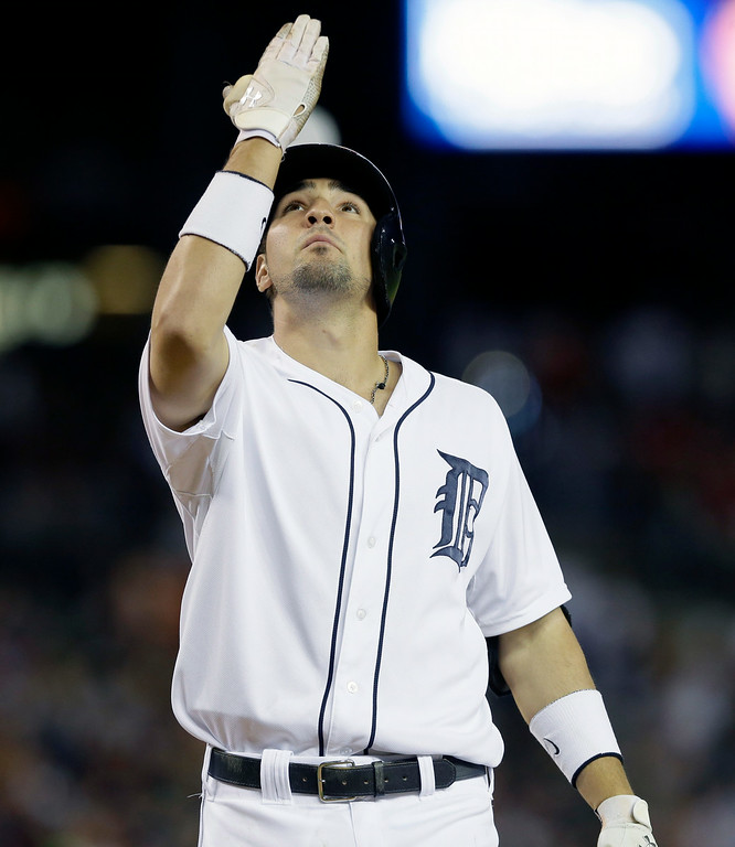 . Detroit Tigers\' Nick Castellanos looks skyward as he crosses home plate after his solo home run during the sixth inning of an interleague baseball game against the Pittsburgh Pirates, Wednesday, Aug. 13, 2014 in Detroit. (AP Photo/Carlos Osorio)