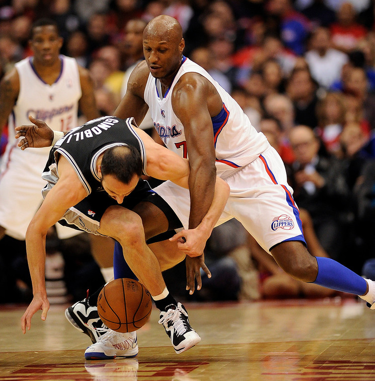 . Clippers\' Lamar Odom #7 fouls the Spurs\' Manu Ginobili #20 during their game at the Staples Center in Los Angeles Friday, February  21, 2013.  (Hans Gutknecht/Los Angeles Daily News)