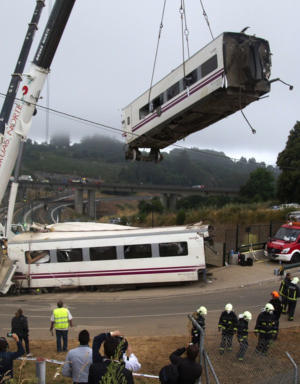 . A crane removes a derailed train\'s car at the site of a train accident near the city of Santiago de Compostela on July 25, 2013.     AFP PHOTO/ STR-/AFP/Getty Images