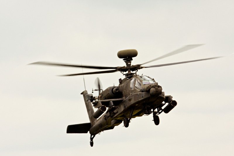 AH-64 Apache Longbow attack helicopter.  The rotor blades 'cone' upwards a fair amount as the power increases.