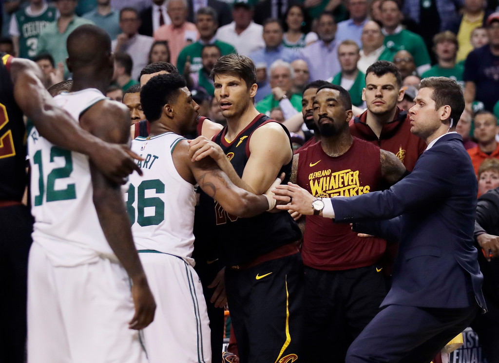 . Cleveland Cavaliers and Boston Celtics players hold each other back after shoves between Celtics forward Marcus Morris andCavaliers forward Larry Nance Jr. during the second quarter of Game 5 of the NBA basketball Eastern Conference finals Wednesday, May 23, 2018, in Boston. (AP Photo/Charles Krupa)