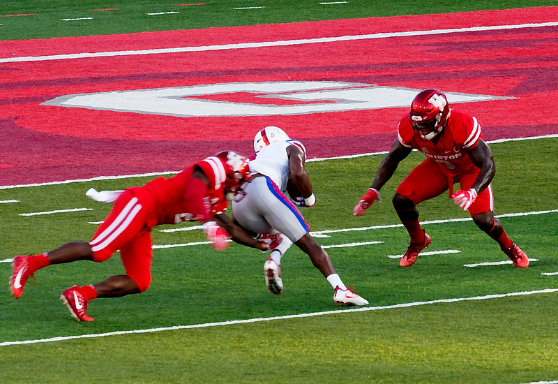Adams stops Proche from making an SMU touchdown (dry brush rendering)  ...