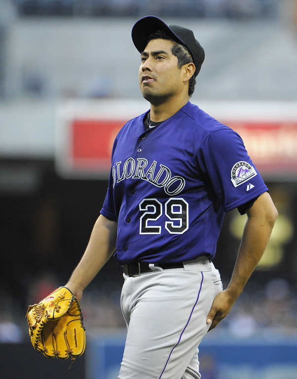. SAN DIEGO, CA - JULY 10:  Jorge De La Rosa #29 of the Colorado Rockies stands on the mound after throwing a pitch during the first inning of a baseball game against the San Diego Padres at Petco Park on July 10, 2013 in San Diego, California.  (Photo by Denis Poroy/Getty Images)