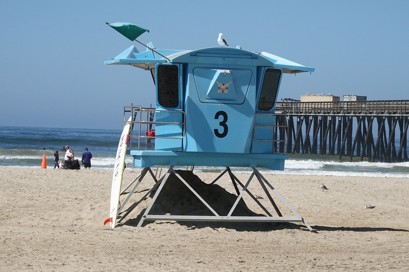 A shiny blue lifeguard station near the Pismo Beach Pier