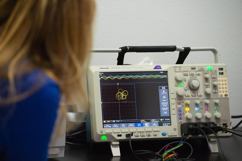Michael Van Den Eijnden teaches Cate Rudowsky about the oscilloscope.
