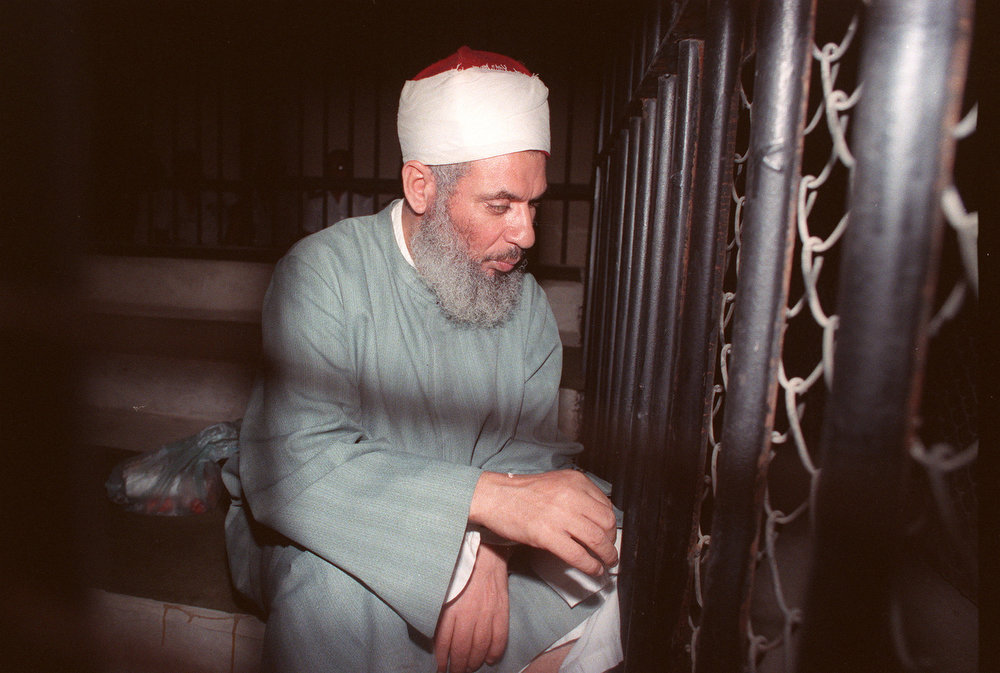 Description of . Blind Sheikh Omar Abdel Rahman, 49, sits and prays inside an iron cage at the opening of court session in Cairo on August 6, 1989. Rahman, spiritual leader of Egypt's main armed group the Moslem fundamentalist Jamaa Islamiyya, was jailed for life in January 1996 for his role in a terrorist plot against the United States and an assassination bid against Egyptian President Hosni Mubarak. He has also been implicated in the 1993 bombing of the World Trade Center in New York. (MIKE NELSON/AFP/Getty Images)