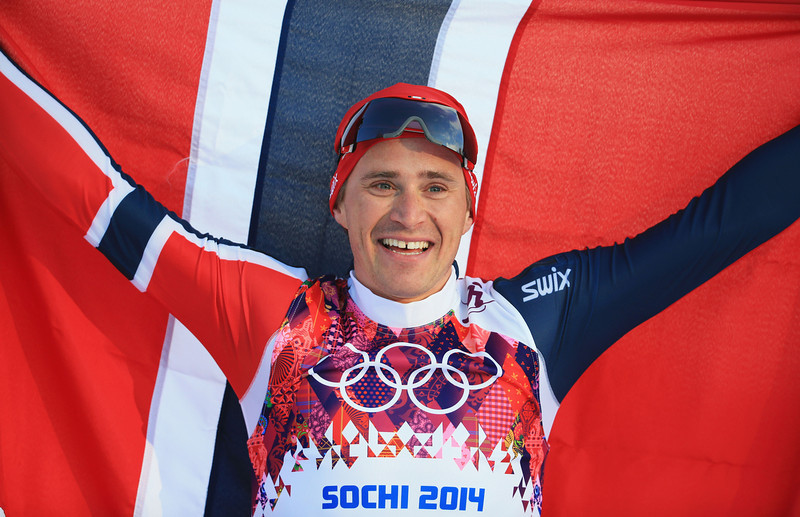 . Ola Vigen Hattestad of Norway celebrates winning the Finals of the Men\'s Sprint Free during day four of the Sochi 2014 Winter Olympics at Laura Cross-country Ski & Biathlon Center on February 11, 2014 in Sochi, Russia.  (Photo by Richard Heathcote/Getty Images)
