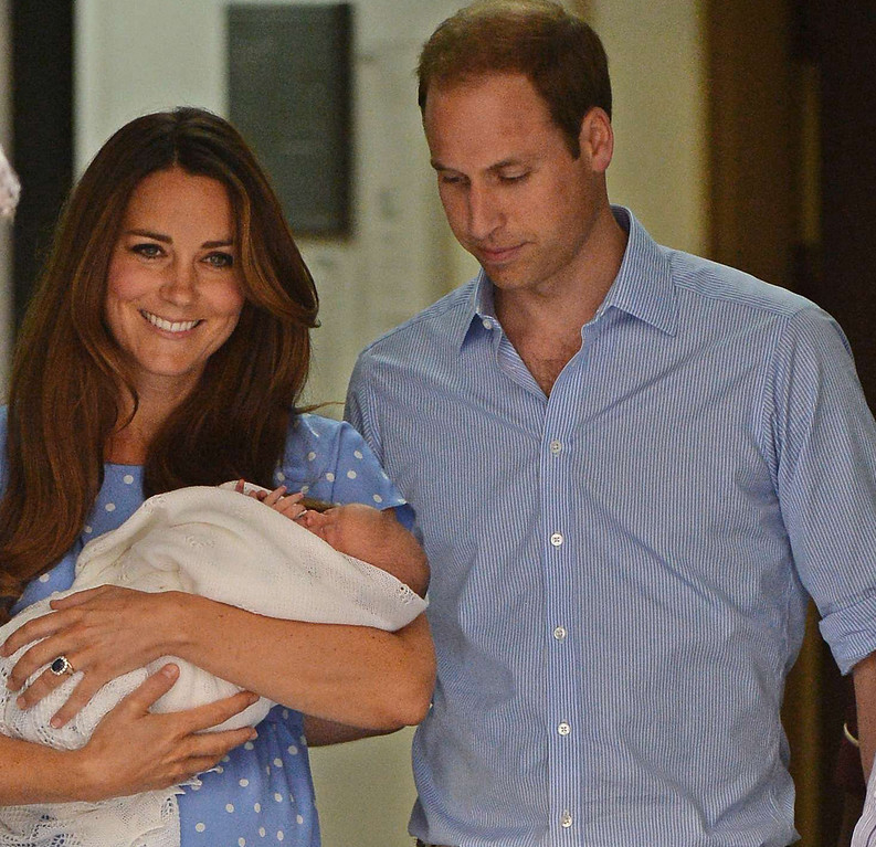 . Prince William and Catherine, Duchess of Cambridge show their new-born baby boy to the world\'s media, leaving the Lindo Wing of St Mary\'s Hospital in London on July 23, 2013. The baby was born on Monday afternoon weighing eight pounds six ounces (3.8 kilogrammes). The baby, titled His Royal Highness, Prince (name) of Cambridge, is directly in line to inherit the throne after Charles, Queen Elizabeth II\'s eldest son and heir, and his eldest son William. AFP PHOTO / LEON NEALLEON NEAL/AFP/Getty Images