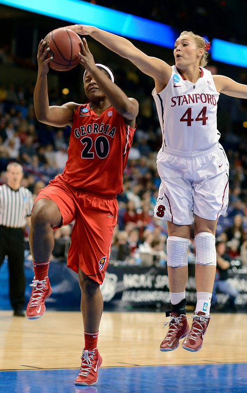 . Georgia\'s Shacobia Barbee (20) makes a drive as Stanford\'s Joslyn Tinkle (40) gets a hand on the ball in the first half of a regional semifinal in the NCAA women\'s college basketball tournament, Saturday, March 30, 2013, in Spokane, Wash. (AP Photo/Jed Conklin)