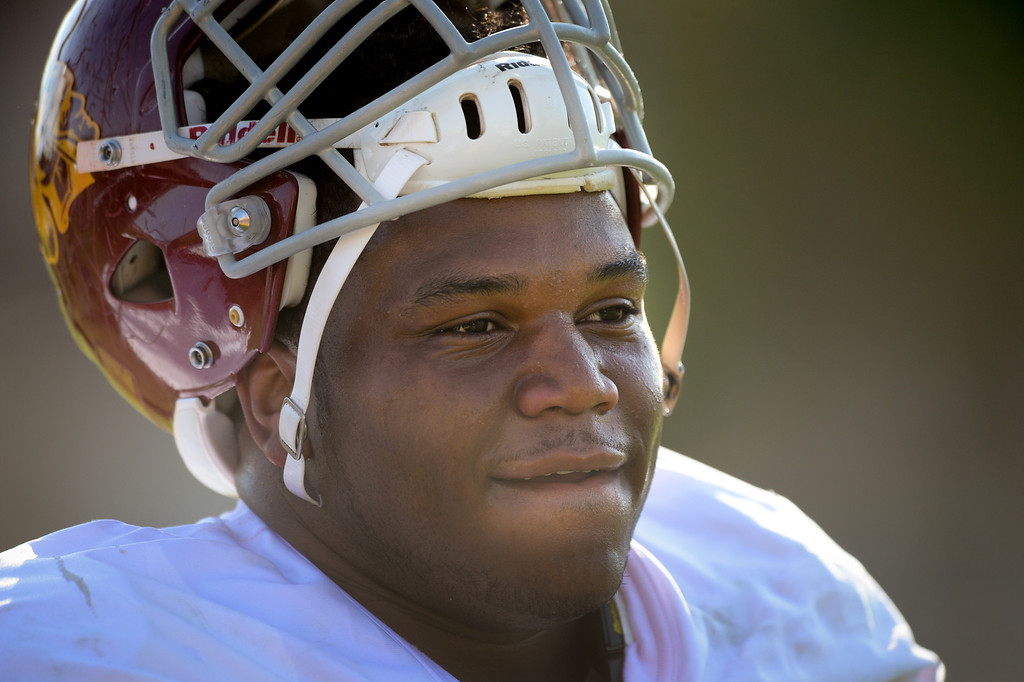 . USC DL Antwaun Woods takes a breather at practice, Thursday, March 27, 2014, at USC. (Photo by Michael Owen Baker/L.A. Daily News)