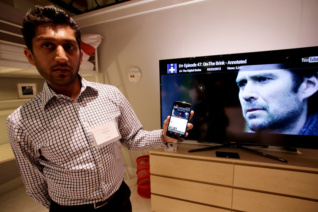. Suveer Kothari of Google demonstrates how a Chromecast media device can transfer web content from his Android device directly to a television at Dogpatch Studios in San Francisco, Calif. on Wednesday, July 24, 2013.  (Gary Reyes/Bay Area News Group)