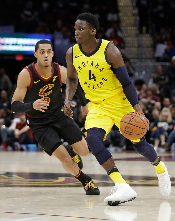. Indiana Pacers\' Victor Oladipo (4) drives against Cleveland Cavaliers\' Jordan Clarkson (8) in the second half of Game 1 of an NBA basketball first-round playoff series, Sunday, April 15, 2018, in Cleveland. (AP Photo/Tony Dejak)