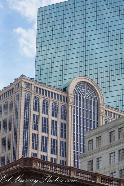 "Buildings....This was taken in Boston.  I happened to look up and saw these buildings at different heights and angles all clustered together. BTW - Thank you for all your comments this week and feedback to yesterday's query about the ""Thumbs"" person. Have a great weekend - see you next week!"