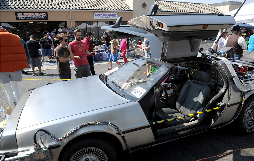 ". (John Valenzuela/Staff Photographer)  Chris Boutwelo and Glenn Liebler both of Redlands look at a replica Delorean time machines from the movie ""Back to the Future\"", on display outside of Super Bad Action Figures in Redlands, Saturday, September 14, 2013."