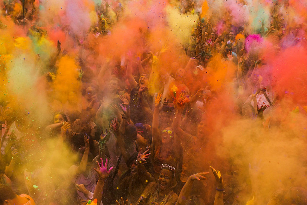 . Revelers throw special colored powders into the air during a Monsoon Holi Festival in Madrid, Spain, Saturday, Aug. 9, 2014. (AP Photo/Andres Kudacki)