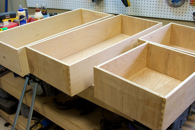 Assembled drawer boxes.  Next up solid wood fronts, and drawer rails.